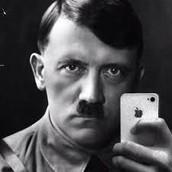 1914 Hitler begins military service in World War I.