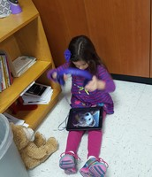 Ava creating a story with her stuffed friend.