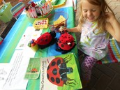 Madison giggles at the Grouchy Ladybug