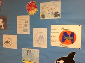 Seniora Carey displays her 4th grade Spanish class student's 'fin'tastic posters in her classroom.
