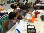 3d Students inquiring into properties of 3d shapes