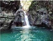 Visit the Damajaqua Cascades
