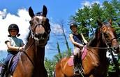 Karen and Benny riding horses