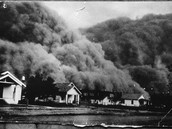 Dust Clouds Flow over Houses