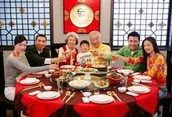How would a Chinese family be influenced by Confucian teachings?