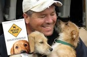 Greg and some dogs he rescued