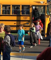 Fourth and fifth grade students returning from field trip to the Shalin Liu.