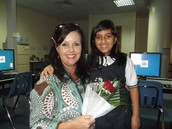 Kim receiving flowers from a student on her birthday UAS Dubai