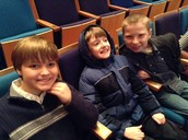 Jaxon, Gabriel and Logan from Mrs. Hansen's class are relaxing as they wait for the symphany music to begin.