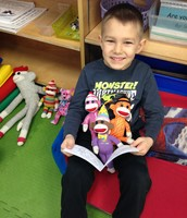 "Evan reading to his ""partners"""