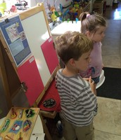 Brady and Skylar listening to Peter and the Wolf before sketching
