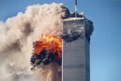 Twin Towers burning after planes crashed into them.