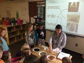 Srta. Cook actively engaging her students in a science unit on rocks, clay, and soil, etc.