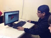 Kenny Patel is working on his train he designed using Autodesk Inventor.