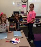 Elizabeth mentoring in the Kindergarten classroom