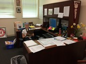 Getting a feel for the Principal's desk!!