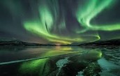 The Cause of Aurora Borealis