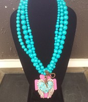Handmade Beaded Necklace with Clay Cross
