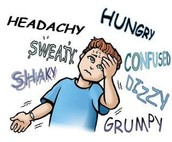 A boy is experiencing hypoglycemia