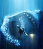 Megalodon shark about to eat a scuba diver under water