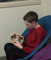 Landon relaxing with a book