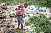 Two Children Walking in Garbage