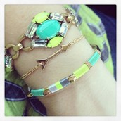 Layered bracelets create an arm party!