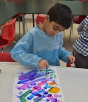 Saaqib painting with cotton balls
