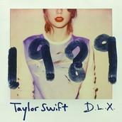Me gustaría un CD de audio 1989 - Edición Deluxe de Taylor Swift. Es azul y blanco y cuesta veinte euros.