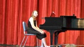 "Lauren Archer earned a ""1"" rating on her piano solo AND trumpet solo!"