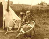 This is a native american elder making snowshoes for the children to play in the snow with.