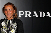 Miuccia next to Prada logo