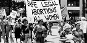 """""""Safe legal abortions, all women."""""""