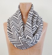 A white and gray scarf goes best with any outfit