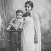Gandhi as a baby with his Mom