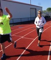 Superintendent, Ms. Feola, sprints to support students
