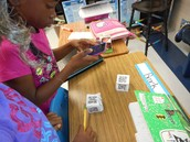 Active math lesson on rounding using a mobile device, QR codes and working in pairs in Teri Childress 4th grade room (#8 Cooperative learning)