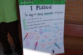 Students sign a pledge to continue to support energy efficiency practices