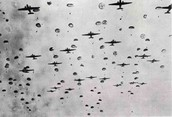 the sky was dark and littered with planes and troopers and chutes