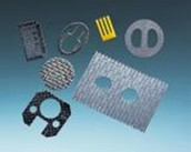 Variety of composites and laminates produced using abrasive waterjet cutting. Photo provided by FLOW.
