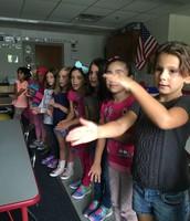 Girls doing an alphabet chant