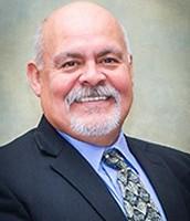 Dr. Gil Mendoza