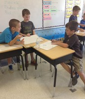 Kyle, Ethan and Joey playing their addition game