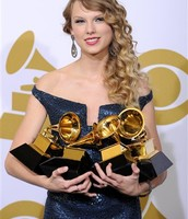 Taylor Swift with her awards