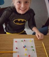 Superhero and math through manipulatives in Laura Archer's third grade class