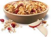Granola cereal, yogurt, a sliced apple