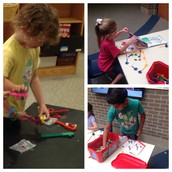 Students working with magnets and building in the Maker space!
