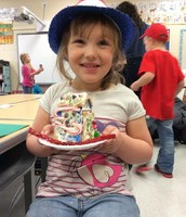 Mrs. Thompson's Kindergarten class showing off their Gingerbread Houses