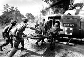 Injured soldier being carried to care