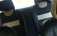 THE LEATHER SEATS OF THE PARIS IQ MOTORCAR